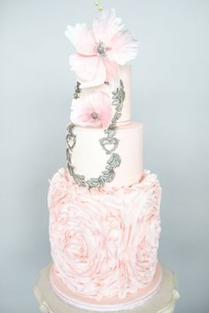A towering ruffled cake designed by Cocoa Lane Sweeterie | Photo by Haley Photography