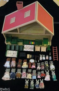 """VINTAGE 1985 SYLVANIAN FAMILIES DELUXE FAMILY HOUSE BY TOMY! THE HOUSE IS IN EXCELLENT CONDITION WITH OPEN & CLOSE DOOR AND WINDOWS """"HARDWOOD"""" FLOORS & 2 WORKING SKYLIGHTS! $95 THE HOUSE MEASURES APPROXIMATELY 13"""" TALL, 11"""" WIDE AND 18"""" LONG."""