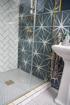 Alex Steadman from The Frugality loved her floor tiles in their old house so much she repurchased them! Metro White on the walls and Shapes Matt White Hexagon mosaic on the floor!