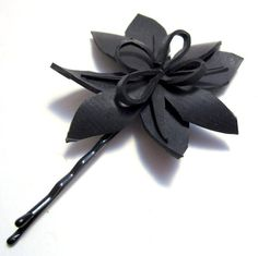 Eco Friendly Hairpin - Looped Flower  from Recycled Innertubes. $10.00, via Etsy.