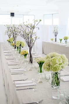 Simple and elegant wintery theme tabletop design. Michael George Flowers