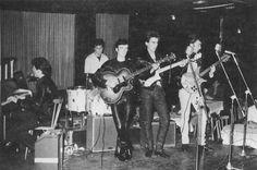 1961, April, At the Top Ten Club, Pauli, Hamburg, Germany. From left to right: Paul McCartney (piano), Pete Best, Stuart Sutcliffe, George Harrison, John Lennon.