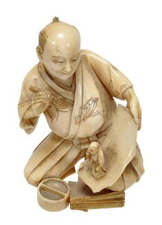 A Japanese ivory netsuke/okimono, depicting a kneeling painter being startled as he holds up the scroll he has been working on to find the figure of a monk he has just rendered has come alive, his robe chased with butterflies, bears a himotoshi to the back, signed, early 20th century