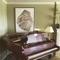 Huge Tree ring print made with Gold ink above the grand piano. #lintonart #treeringprints #Treelovers #interiorart #hotelart #apartmenttherapy #Officedesign #giftsforhim #giftsforher #etsyseller #pianoroom #livingroomart