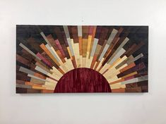 Welcome to Rising Sun Woodwork, wooden wall art inspired by the beauty of space and astronomy. Name: Helios Size: 44w X 22h Availability: Made to order HELIOS is a celebration of the sun. I wanted to make a sunset piece with a huge sun presence, grain just swimming all over the