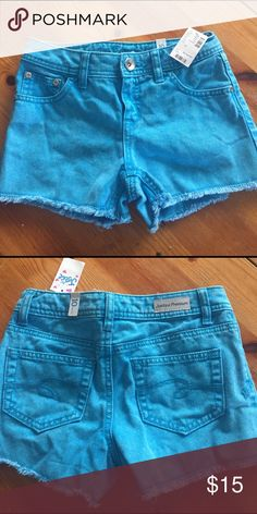 NWT Turquoise Denim Shorts Super cute and perfect for spring! Justice Premium jean shorts. Bundle and save! Free shipping on bundles of over $50! Justice Bottoms Shorts