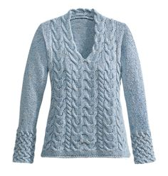 Blue Sky Sweater. This Aran sweater is enhanced with a wide band of basket knit on the sleeve, elegant V-neck trimmed with scalloped horseshoe stitch. In a pale sky blue flecked with deeper blues and auburn. Merino wool with cashmere for softness. inspiration, not pattern. - Gaelsong