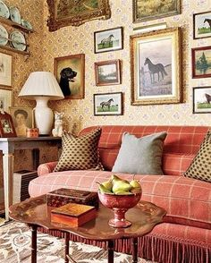 Love the couch and frames.. Hate the wall paper and plates