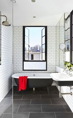 """Classic bathroom elements have been deployed with a modern twist here. """"Subway…"""