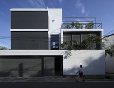 House 1 is a minimalist house located in Sri Lanka, designed by Isurunath Pramitha Associates. Unassuming and minimalist in its principles, this quintessentially cube-like abode sets a criterion for the conception of seamless space in a constrained urban environment. During the daytime the house exudes simplicity and is modest in appearance. (2)