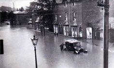 A spot of rain in Smethwick, Flooding in the High Street 1927