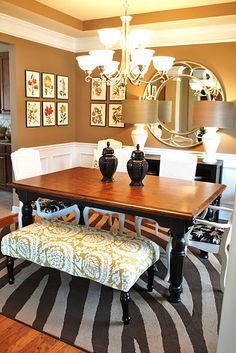 Beautiful dining room.  In particular, the black buffet, black table with stained top.  Wonder if I should paint or stain my table top?
