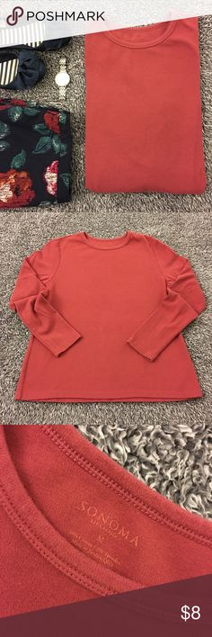Layering staple - long sleeve tee - maroon/rust ! Pre loved with minimal signs of wear but nothing obvious. Great for layering or can be worn as is. Good used shape and from a smoke free home. See pictures for details and condition. Bust is 19 inches flat. Hips are nearly 20. Length is about 24 inches. Long sleeves at 23.5 inches from the shoulder seam to the hem of cuff. Have questions? Ask! Offers and bundles welcomed but please no models or trades! Thanks so much for stopping by! Have a…