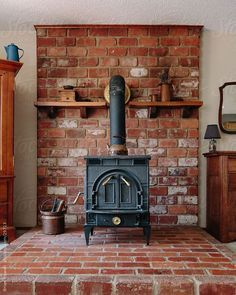 wood burning stove hearth ideas   old wood stove on brick hearth by Brian Powell -