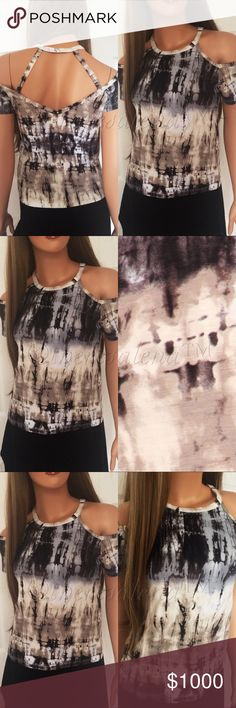 "Black Gray Tie Dye Top Black Gray Tie Dye Top with open-shoulder and comfortable fit!  MADE IN USA!!!    Fabric: 95% Rayon, 5% Spandex Size Scale:  S-M-L Description:  Approximately 20.5"" long  ‼️PRICE ABSOLUTELY FIRM UNLESS BUNDLED‼️ THESE ARE MADE IN USA  BOUTIQUE QUALITY YOU MAY BUNDLE FOR A DISCOUNT TheresaLena Boutique Tops"