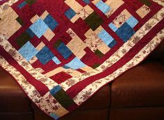 A Patchwork of Garnet Lap Quilt by clubaloha on Etsy