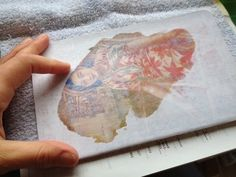 art in red wagons: photo transfer on a moleskine notebook. Complete tutorial - follow the link.