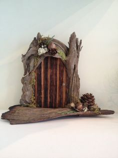 Handmade driftwood fairy door by BlackSquirrelStudios on Etsy, $30.00