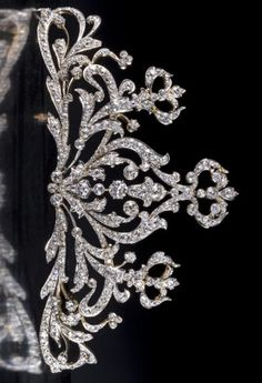 A diamond tiara, designed as a tapered openwork panel of old European-cut diamond scrolls; central diamond weighing approximately: 1.40 carats; remaining diamonds weighing approximately: 35.00 carats total;, mounted in platinum topped eighteen karat gold. #antique #tiara