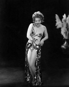 Clara Bow - serpent dress and headdress -- Wow, I never knew she was so naughty!  I've seen several of her films, and she was great.