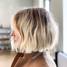 To boot, it's a fresh hairstyle that all textures can get in on. Pair a curly blunt bob with a deep side part? Too cool. #bob #hairstyles #southernliving...