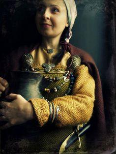 "via thorkilshop.com   ""Viking woman clothing : diamond twill wool. Viking jewelry from Birka and Gotland : tortoise (oval) brooches, trefoil brooch, small round brooch, spiral arm ring. Birka knife. Viking pottery."""