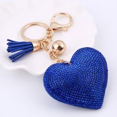 Heart Keychain 6 Colors Full Crystal Key Long Tassel Key Holder Material:Crystal Shape\pattern:Heart Style:Cute/Romantic Metals Type:Zinc Alloy Metal color:Light Yellow Gold Color Style:Romantic Heart size :7*6.5cm items length :15.5cm
