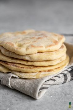 A step-by-step guide to making pita bread at home! This recipe is easy and requires just 5 simple ingredients. After making pita bread at home, you won't ever want store-bought pita ever again! #pita #bread #homemade #5ingredients #fresh #vegan #easy #mediterranean #food #recipe #side #lunch #breads #wrap #sandwich #meal #sweetsimplevegan