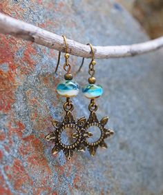 Take a look at this Blue Glass & Bronzetone Open-Sun Drop Earrings today!