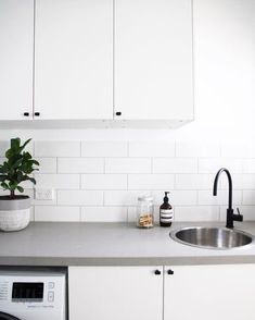 Versatile Concrete Benchtops – Giving Kitchen Trending Feature with Flexibility and Strength Caesarstone Raw Concrete, Concrete Kitchen, Grey Laundry Rooms, Laundry In Bathroom, Laundry Doors, Small Laundry, White Cupboards, Kitchen Cupboards, Dark Cabinets