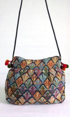 A personal favorite from my Etsy shop https://www.etsy.com/sg-en/listing/245809469/boho-embroidery-crossbody-shoulder-bag