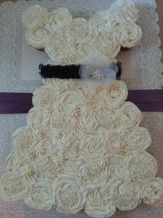 Wedding Dress Cupcake Cake for a weddinh shower..ediable pearls and purple ribbon with white flower for decorations