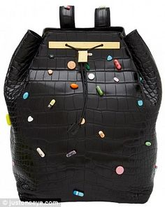 Five figure Christmas gift.  Ashley and Mary-Kate Olsen, the design duo for their label, The Row, have released a $55,000 crocodile skin backpack adorned with prescription pills