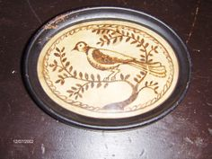 Early style watercolor of a bird in brown in an early oval tin frame by Steve Shelton at Whitehorse Antiques, Rocheport, Mo. (SOLD) Copyright Steve Shelton.