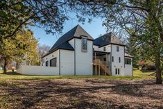 A beautiful home with transitional styling was designed by Millworks Designs, located on an expansive acre lot in Nashville, Tennessee. Facade House, House Facades, Wooden Staircases, Transitional House, Tudor Style, Entry Foyer, Sliding Glass Door, Large Windows, Contemporary Interior
