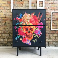 This piece consists of five drawers. All sit on wooden runners. It has been painted black and the drawer fronts decoupaged in our own colourful skulls print. The whole piece has been sealed in layers of a satin finish varnish to give it durability and wear. | eBay!