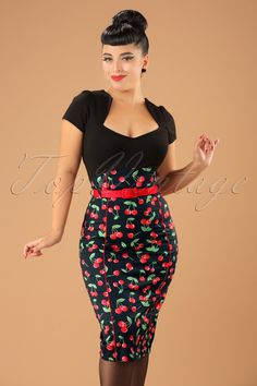 This 50s Cherry Pop Pencil Skirt in Black by Bunny is a sassy pencil skirt!  We just can't get enough of those cute red cherries; the ultimate rockabilly print! Super feminine high waist style which is just a bit different due to its rounded waistband and playful dark red detachable fabric belt. The seams with red piping at the font and back will enhance your curves even more, vavavoom! Made from a light stretchy black cotton blend and finished off with a hidden zipper a...