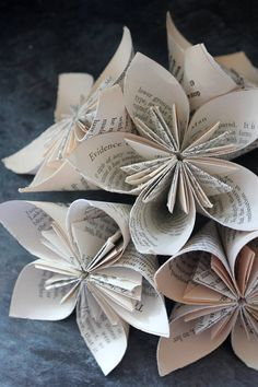 """This listing is for 5 adorable Kusudama Origami flowers. They would be a lovely addition to any event you might be hosting! Handmade from pages of the beloved Anne of Green Gables these flowers have a shabby chic feel about them. They look great scattered on tables, grouped together in a bouquet and many other decorative uses. I used them at my wedding for decor as well as my bouquet, they also made a memento for our guests to take home!  """"Kindred spirits are not so scarce as I used to…"""