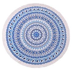 Inspired by Mediterranean mosaic tile, this round towel's kaleidoscope of ocean blues crash round and round in waves. Let go and get lost in this towel.