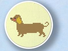 You can get the pattern for this dachshund cross stitch piece from etsy seller andwabisabi