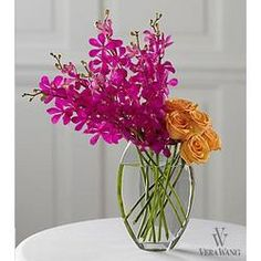 Use different colors, orangey orchids, burgundy roses or chocolate calla lilies instead