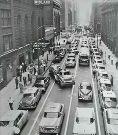 Taxi drivers line Adams Street at LaSalle in support for a controversial new union leader, 1959, Chicago. Notice the city has begun to ticket and tow the protesting drivers.