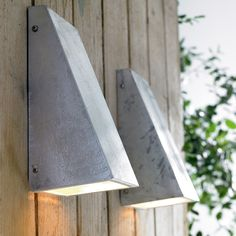 Love the finish on these exterior wall lights.  Could do a DIY version with fibercement board