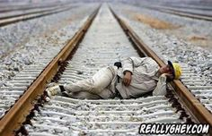 NOT a good place to have a nap / the track will advise he of approaching train by rail rattle / but if too comatose to recognise the rattle ,then will be a VERY long sleep ! Wuhan, Funny People Pictures, Funniest Pictures, People Sleeping, Les Themes, Picture Fails, Before Sleep, How To Fall Asleep, Railroad Tracks