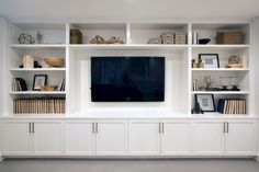 A wall of built-ins for a family room media center. – Addition on Three Floors – Board & Vellum A wall of built-ins for a family room media center. – Addition on Three Floors – Board & Vellum Living Room Built Ins, Living Room Wall Units, Home Living Room, Living Room Designs, Living Room Decor, Wall Cabinets Living Room, Tv Wall Cabinets, Living Room Shelves, Living Room Without Fireplace