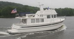 The Nordic Tug 49's swim platform is an integral part of the hull thus boosting her theoretical hull speed.