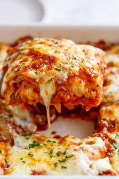 The Best Lasagna is here! Layered with a rich meat sauce and a creamy parmesan white sauce, plus the perfect amount of mozzarella cheese! NO ricotta cheese needed!