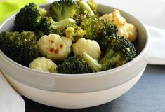 Roasted Broccoli and Cauliflower with Lemon and Garlic! I absolutely love roasted vegetables of any kind! Even for breakfast! I regularly roast cauliflower by itself to have as a snack like popcorn…