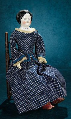 "24""~German Porcelain Doll with Rare Beaded Necklace, on Early Wooden Chair~~~Comments: Germany, circa 1880. Value Points: rare beaded necklace, original body with beautiful antique costume, posed seated on early wooden doll chair with carved back slats and woven seat."