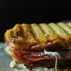 Italian Panini Recipe Lunch and Snacks with sourdough bread, sun-dried tomatoes, fresh mozzarella cheese, smoked turkey, peppered salami, pepperoni, salted butter